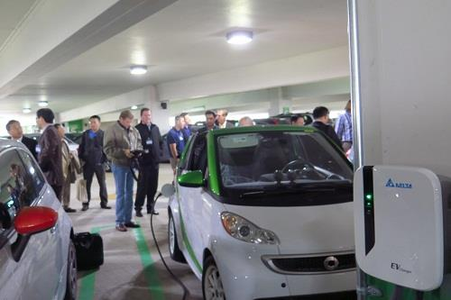Some of guests use Delta's chargers to charge their EVs during the on-site demonstration.