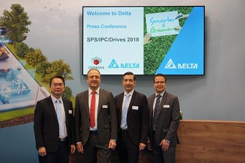 Andy Liu (L1), general manager of Delta's industrial automation business group, and Dieter Hess, CEO of  the CODESYS Group, photoed at the press conference